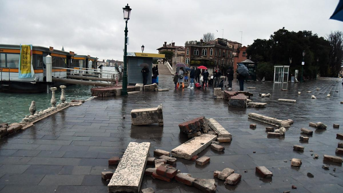 A dock, partially flooded, lies damaged in Venice on Wednesday.