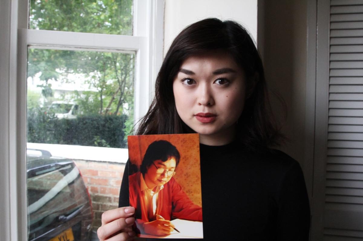 Angela Gui, 22, became a human rights campaigner after her father, Gui Minhai, a Hong Kong bookseller, was put in Chinese detention. She holds a photo of her father at her home in the English Midlands.