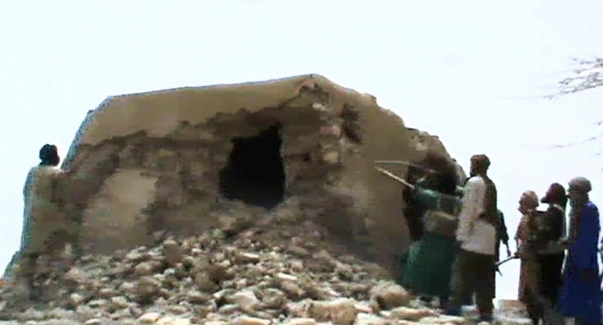A still from a video shows Islamist militants destroying an ancient shrine in Timbuktu on July 1, 2012. At the time, the International Criminal Court warned that their campaign of destruction was a war crime. The hardline Islamists considered the shrines