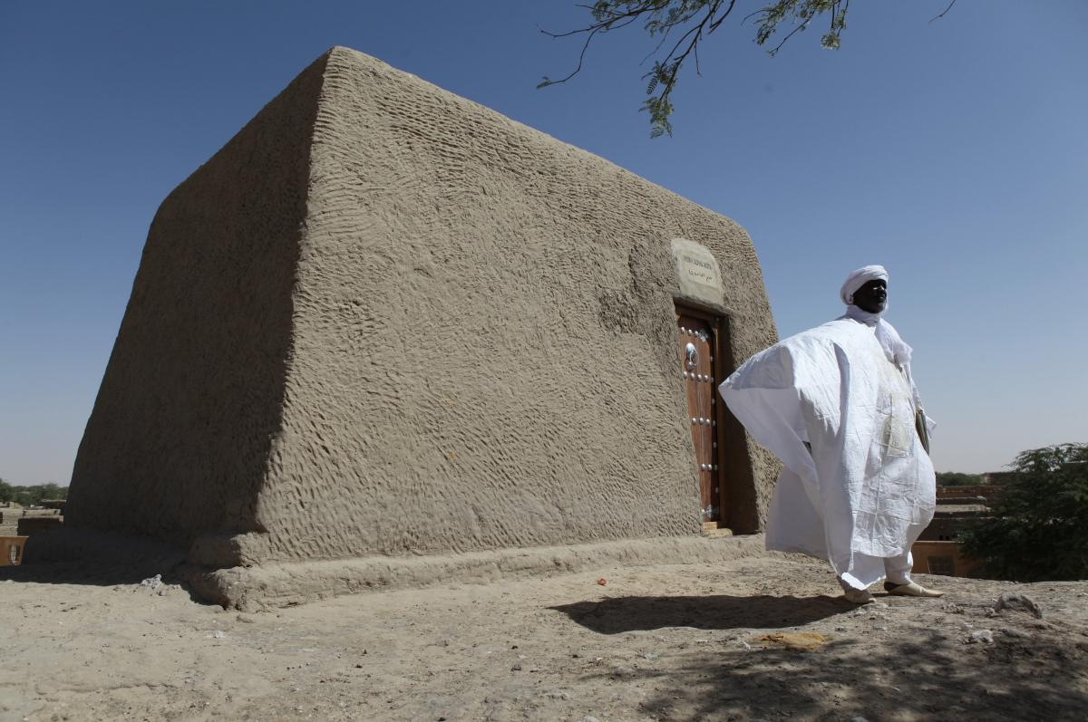 Sane Chirfi, representing the family that looks after the mausoleum of Alpha Moya, poses in front of the mausoleum on Feb. 4 in Timbuktu. Historic mausoleums, destroyed during an Islamist takeover of northern Mali in 2012, were rebuilt thanks to the U.N.