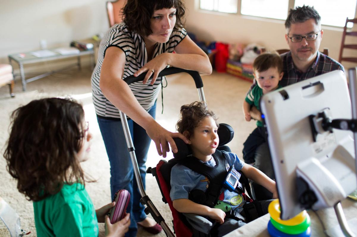 """Gideon, 3, communicates with his parents Kathleen Muldoon and Seth Dobson, his sister Genevieve and brother Cormac, using an electronic device they call, """"Gideon's talker."""""""