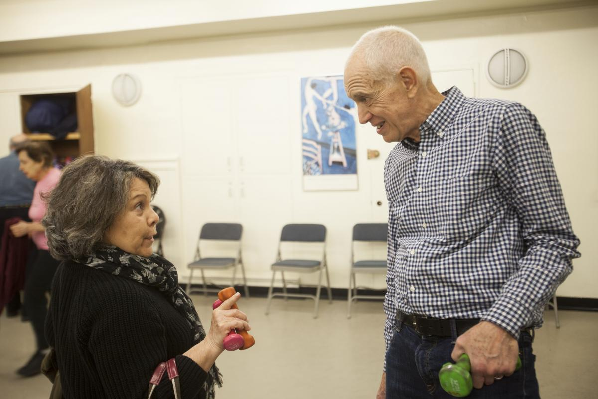 David chats with one of his students after his exercise class at the 92nd Street Y.