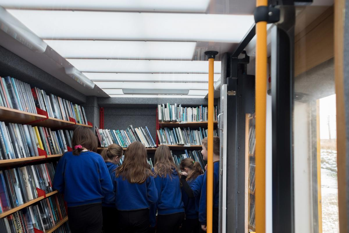Students at the Sgoil an Taobh Siar primary school in Barvas choose books from the mobile library van. Most school libraries have limited and outdated stock, and the mobile van provides more options.