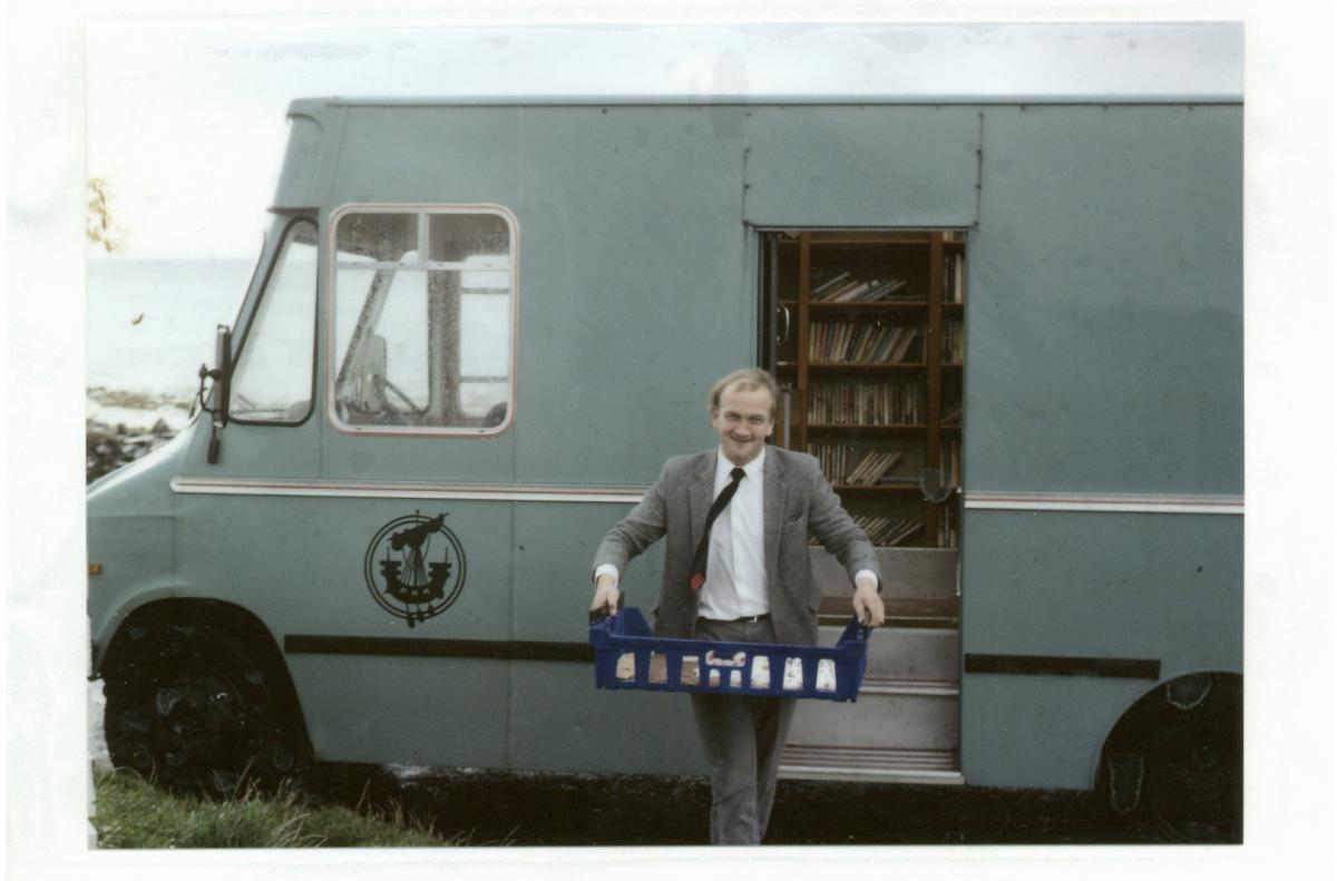 In this archival photo provided by Leabharlannan nan Eilean Siar, Donald J. Macdonald exits one of the mobile library vehicles. Macdonald served as the Uist mobile librarian from 1988 to 2003. The Outer Hebrides originally had three vans: two for Lewis an