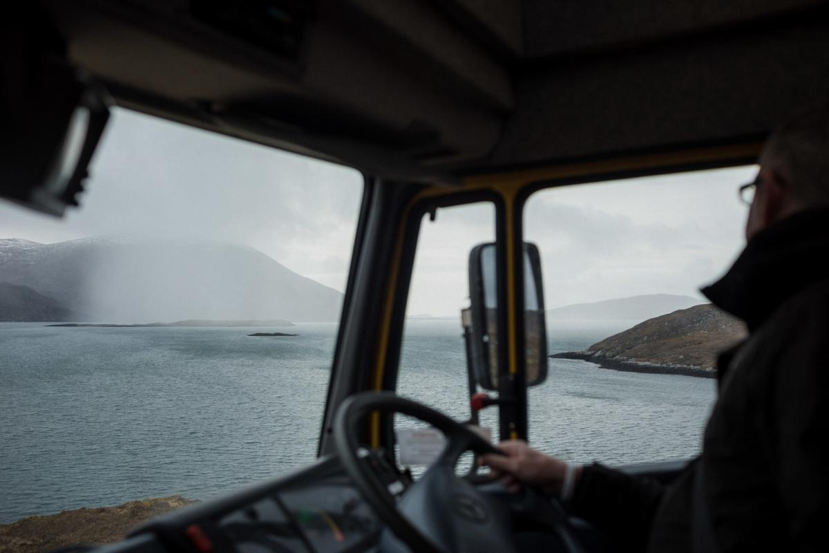 Mobile librarian Steven Bryden watches gusts of rain sweep across west Harris while on the road back from Hushinish. Inclement weather and aging vehicles are the most frequent causes of service disruption.