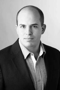 Brian Stelter is a reporter at The New York Times and was the founder of the website TVNewser.
