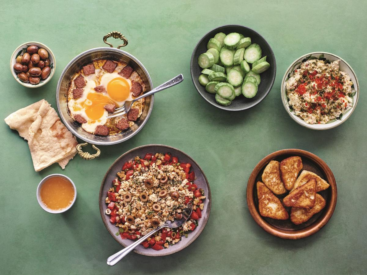 """Kassis explores the cross-cultural culinary history of the Arab world in her cookbook The Arabesque Table. Shown above (clockwise from top left): sujuk fried eggs; """"secret"""" Shankleesh salad; fried Arabic white cheese; and labaneh, red chili and egg salad."""
