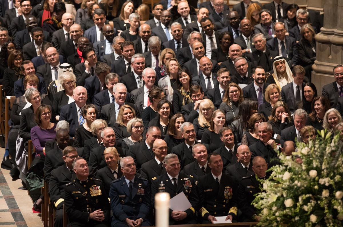 Dignitaries listen to former President George W. Bush who eulogized his father.