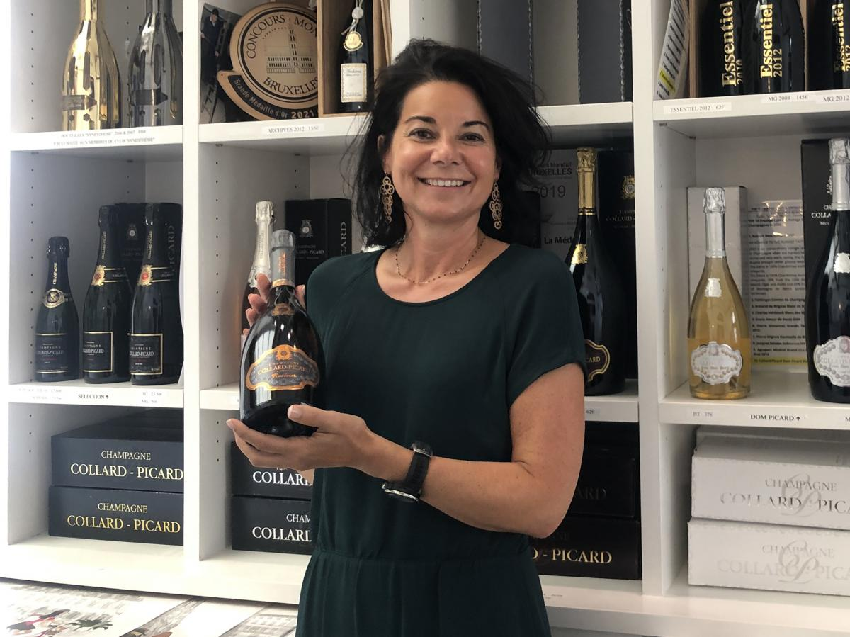 """Marie Collard of the champagne house Collard-Picard in her retail shop in Epernay, France. Collard has not yet decided whether to remove the word """"champagne"""" from her labels in order to sell the bubbly in Russia."""