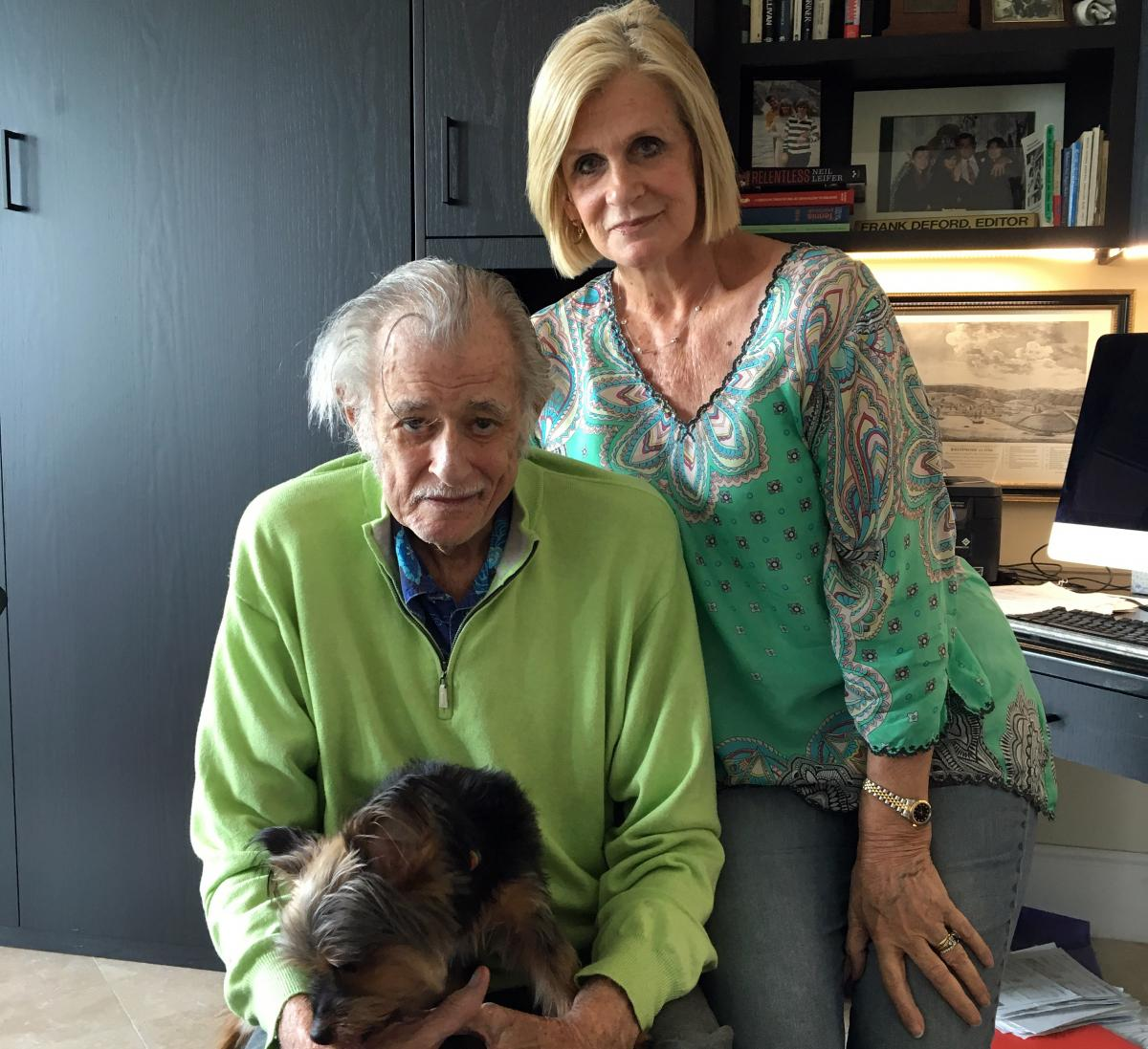 Frank Deford, his wife, Carol, and their dog, Miss Snickers, in his home office in Key West, Florida. On Wednesday, Deford retired from Morning Edition as sports commentator.