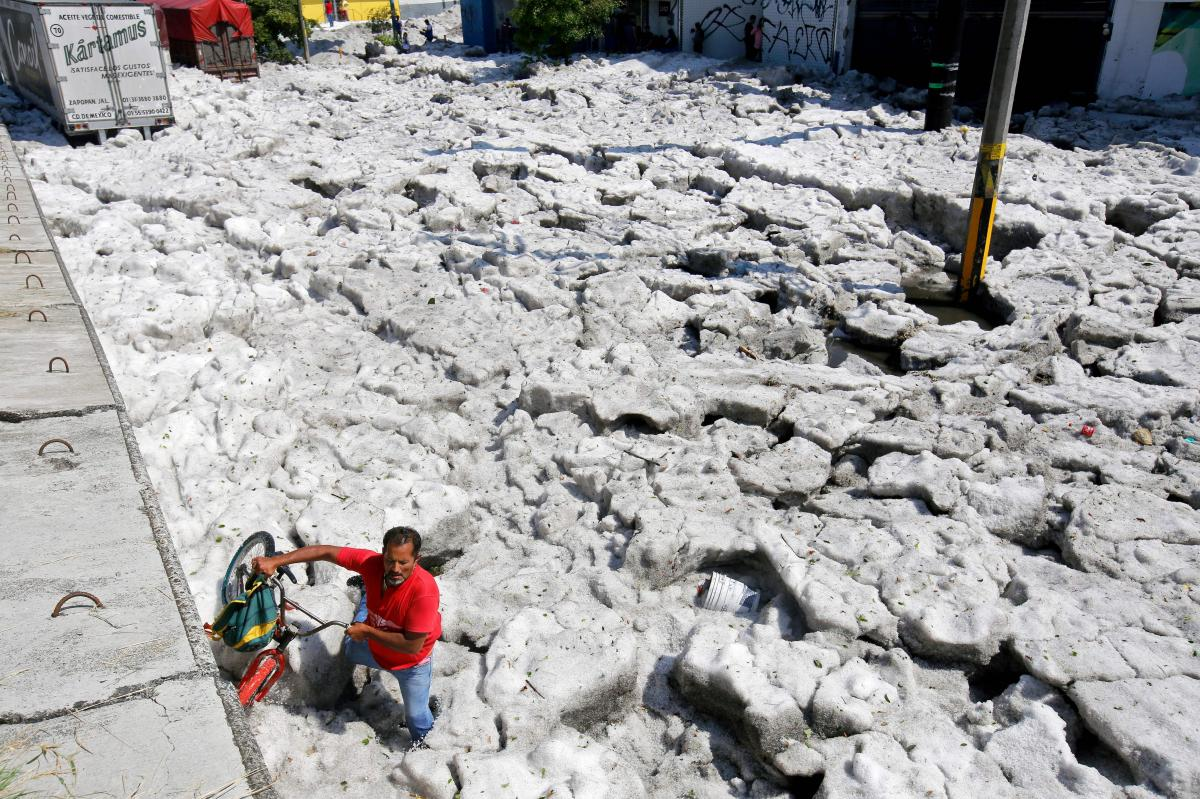 The blanket of hail made it difficult to get around the Mexican city of Guadalajara on Sunday.