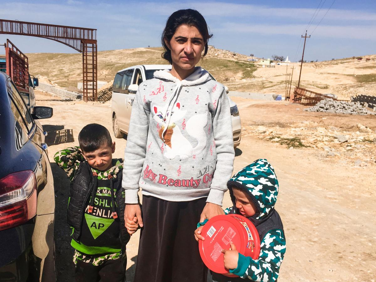 Berfe Khalaf with her children Jager (left) and Jan on Mount Sinjar two days after crossing back to Iraq from Syria, where they were held captive by ISIS. Khalaf's husband was executed by ISIS.