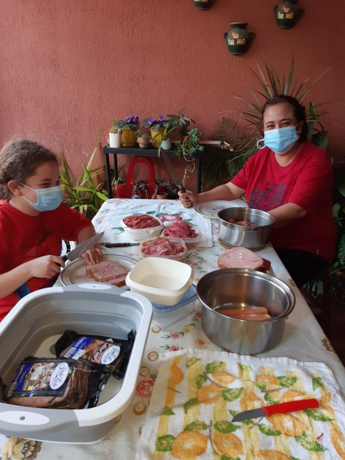 Pandemic food prep: Ana Michelle Dubon Estrada made fiambre, a traditional Guatemalan salad-like dish served on the Day of the Dead, with her daughter in her grandmother's garage — while grandmother called out instructions from a nearby doorway.