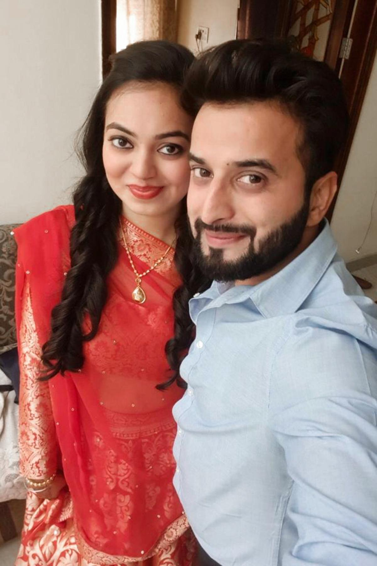 Tushar Mehta and his wife, Riddhi, on Diwali. The couple joined friends for their traditional holiday card games but used a digital version.