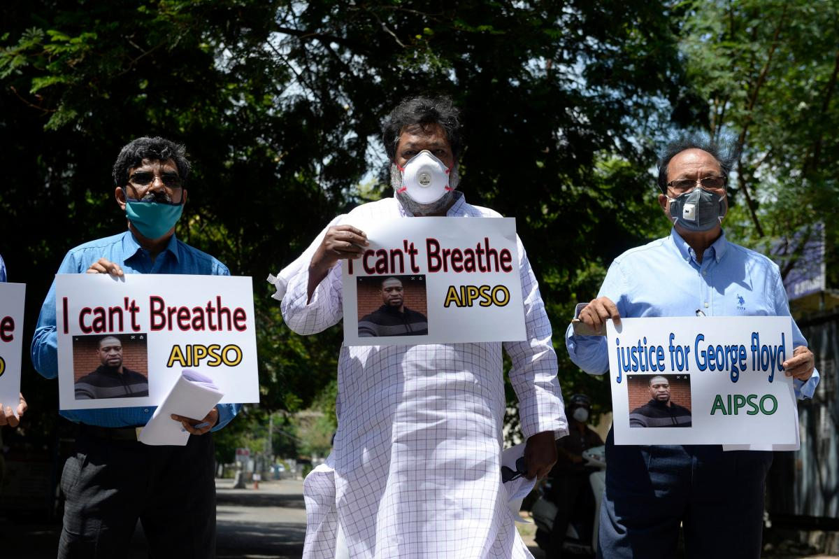 Members of the All India Peace and Solidarity Organization hold placards in silent protest at the U.S. consulate in Hyderabad, India, on June 4.