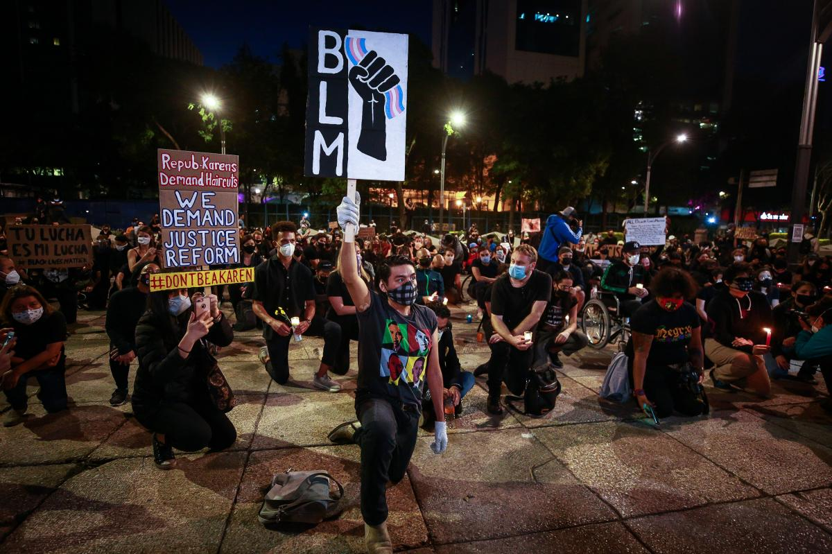 A man kneels during a protest against police brutality in Mexico City on June 4.