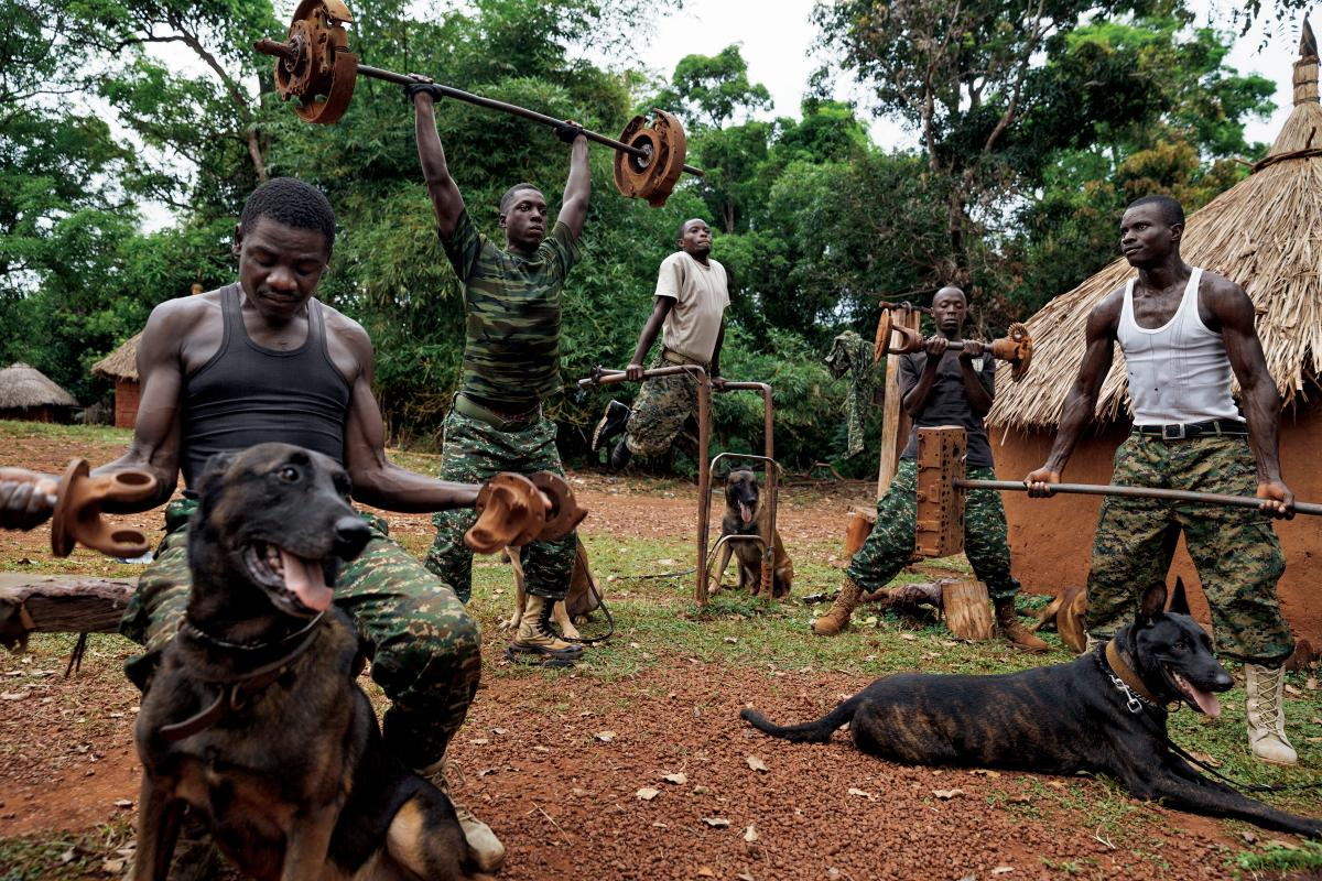 Members of the Ugandan army's dog-tracking team lift weights at the African Union base in Obo, Central African Republic. The dogs are Belgian Malinois shepherds, famed for their use in military operations, especially in tough conditions like the dense cen