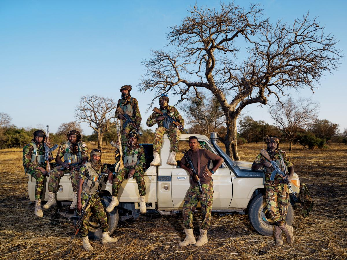 """Zakouma's Mamba Team 1 anti-poaching unit includes driver Issa Adoum (brown shirt). After Sudanese poachers killed his ranger father, Adoum refused diya, a traditional community payment. """"Diya is for accidents,"""" he says."""