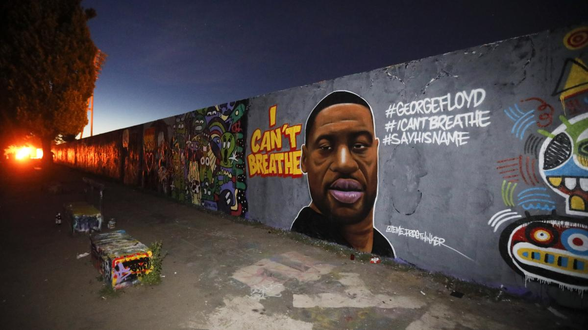 George Floyd, and his last words, were depicted in a mural by graffiti artist 'EME Freethinker' on a section of the former Berlin wall.
