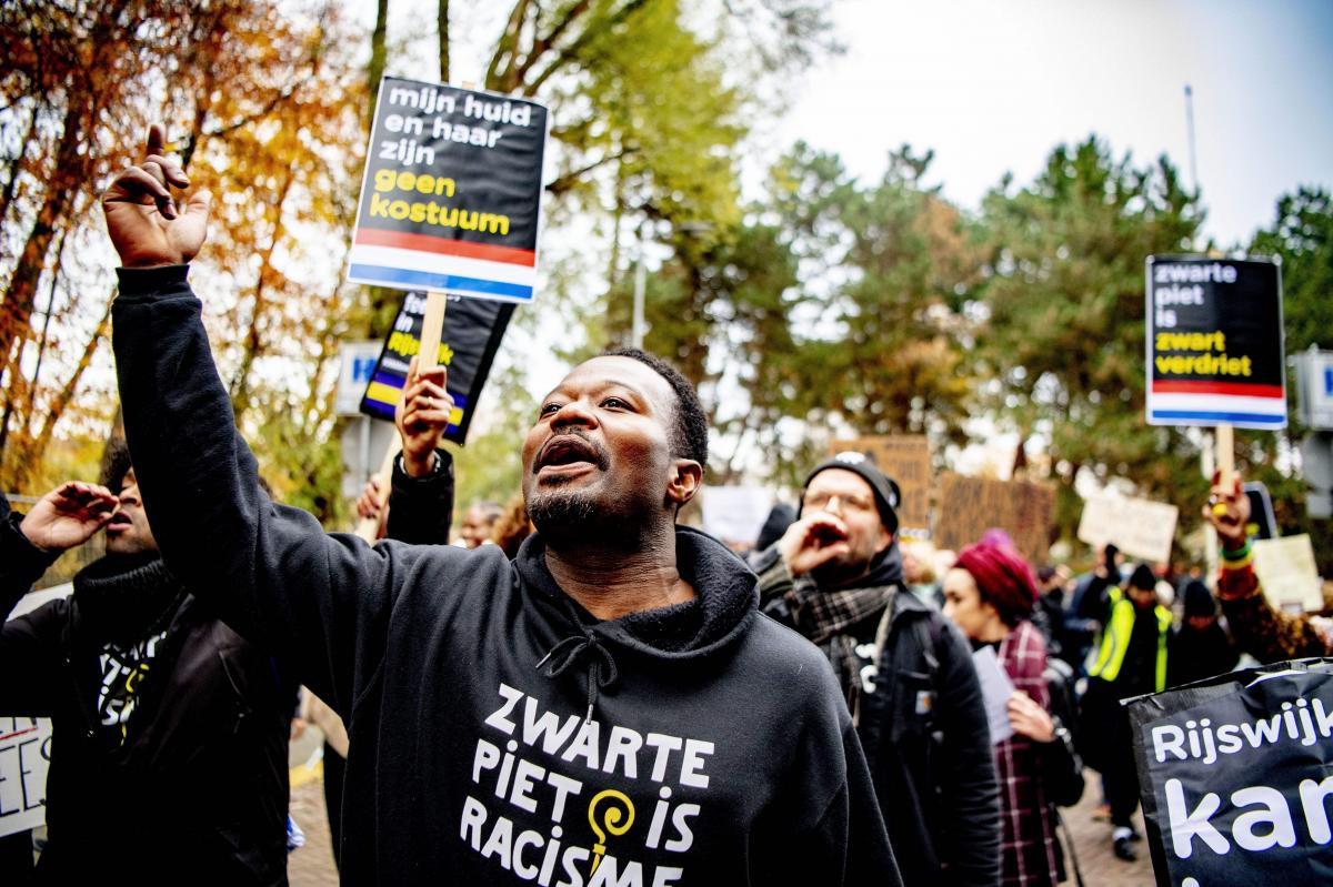 Dutch anti-discrimination activist Jerry Afriyie, leader of the Kick Out Zwarte Piet movement, demonstrates last November in Rijswijk, Netherlands, during the arrival of Sinterklaas and the blackface character who traditionally accompanies him.