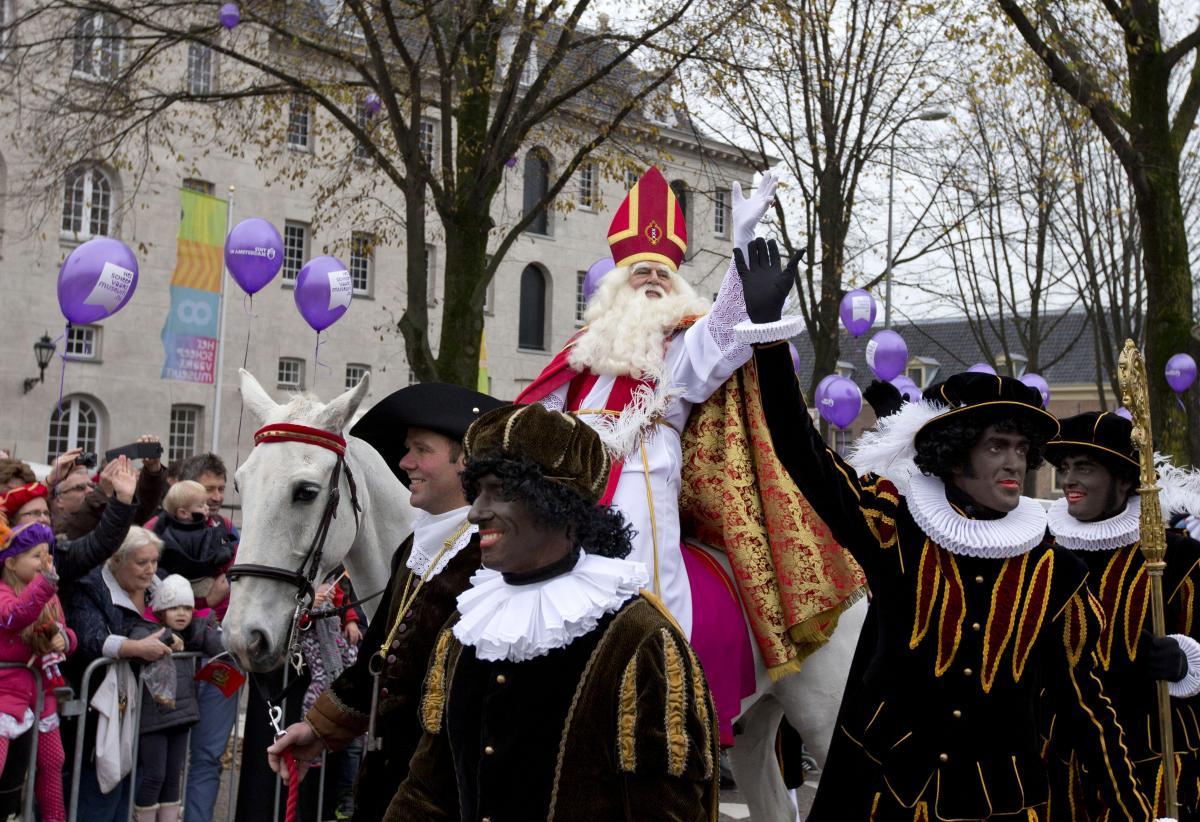 People line the road to greet Sinterklaas and his Black Pete sidekicks in Amsterdam in 2013.