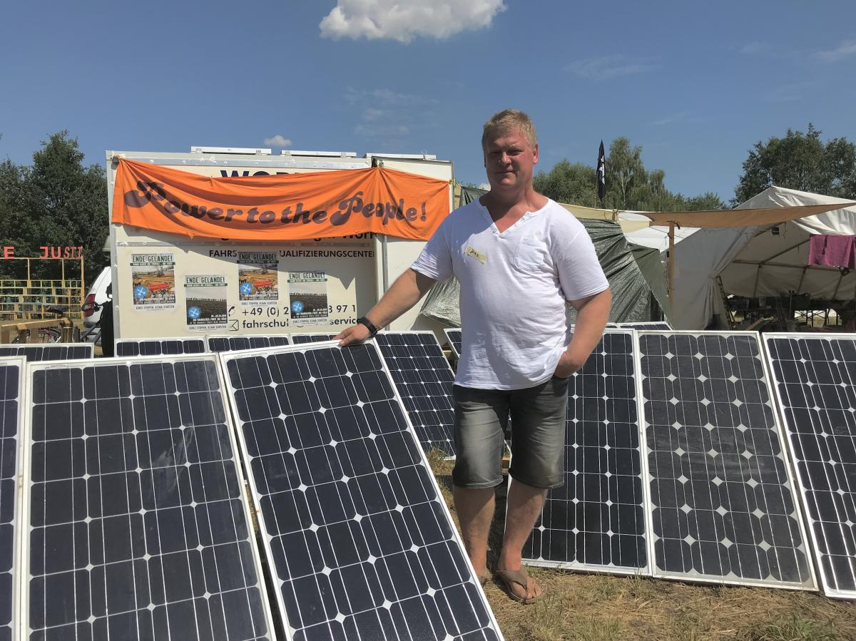 Local Farmer Jens Hausner is determined to stay in Pödelwitz. He says he's optimistic the protest movement will stop the mine from demolishing the village.
