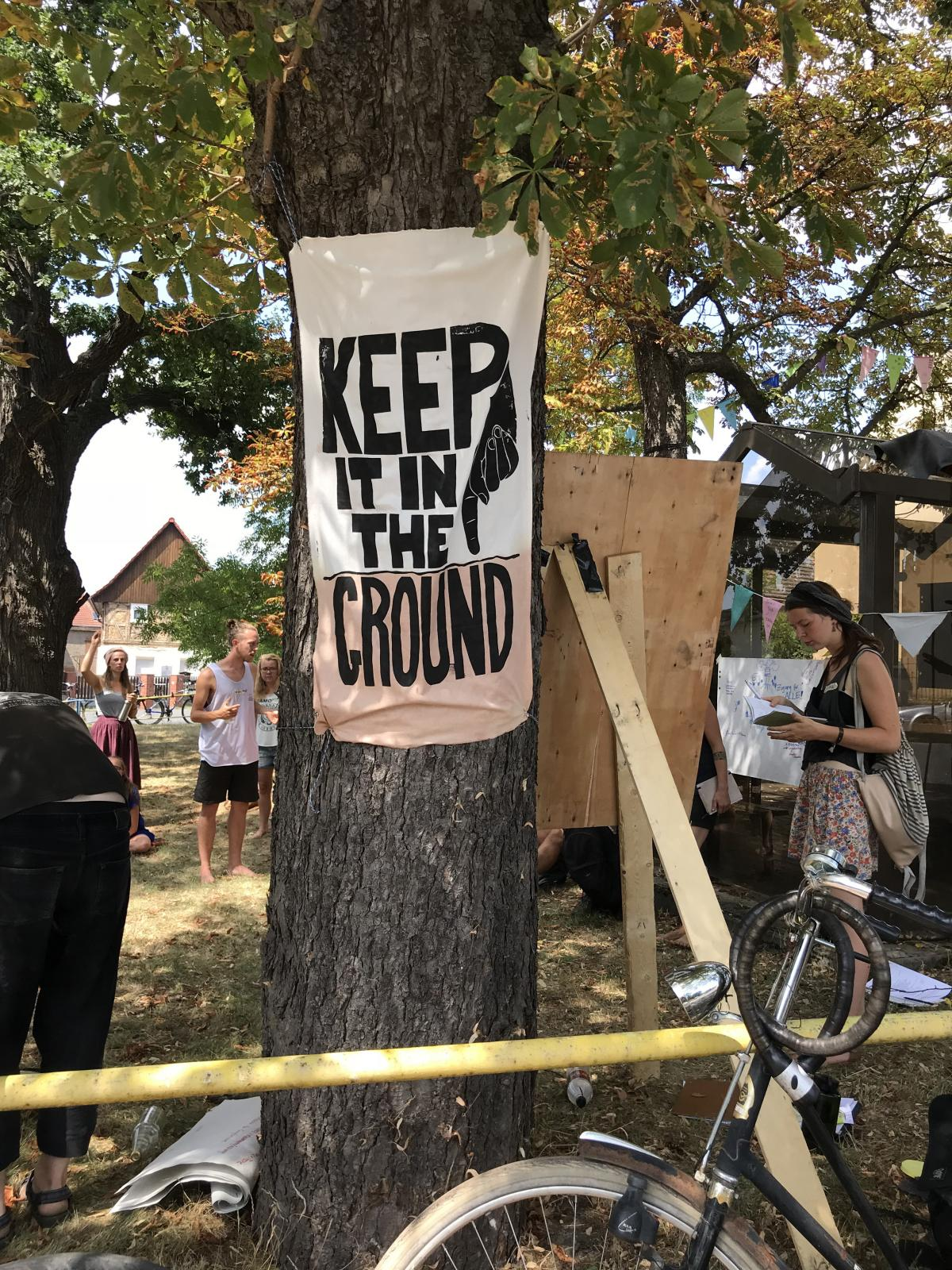 Protesters hang signs against extracting brown coal in the village of Pödelwitz.