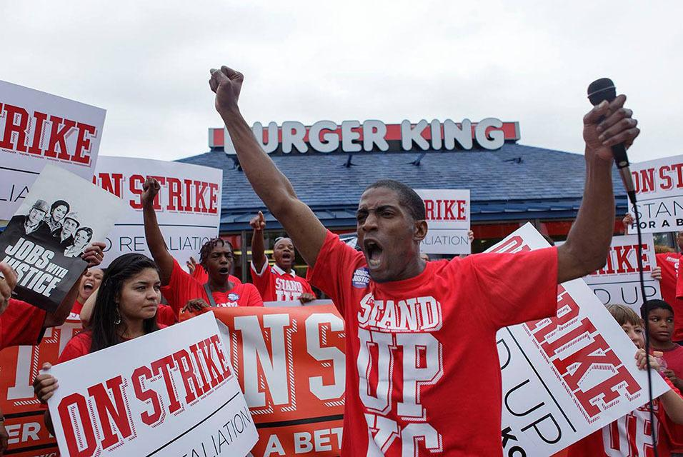 """""""Walking off the job, you're taking on your boss head-on, and that sounds like some pretty scary stuff, right?"""" says fast-food worker Terrence Wise, shown here at a 2013 strike in Kansas City, Mo. """"But I always thought, what am I more afraid of? Taking on"""