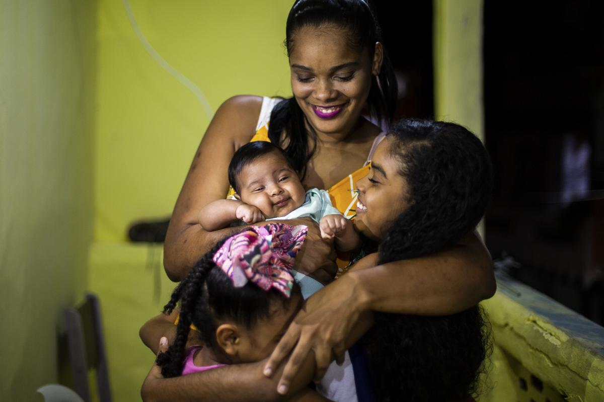 """Renan Benedito photographed Marluce dos Santos Sousa, 32, and Davi, now 2 months old. During her pregnancy, she said, """"I felt immersed in a sea of uncertainty"""" because of COVID-19 and her mother's death. Her son """"brought joy. I know Davi will find a diffe"""