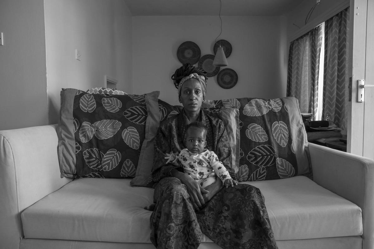 """Sarah Waiswa's self-portrait of herself with Ria at 4 months. """"We went into lockdown a couple of weeks after she was born,"""" she says. """"It's strange not having family around to hold her."""" July 5. Nairobi, Kenya."""