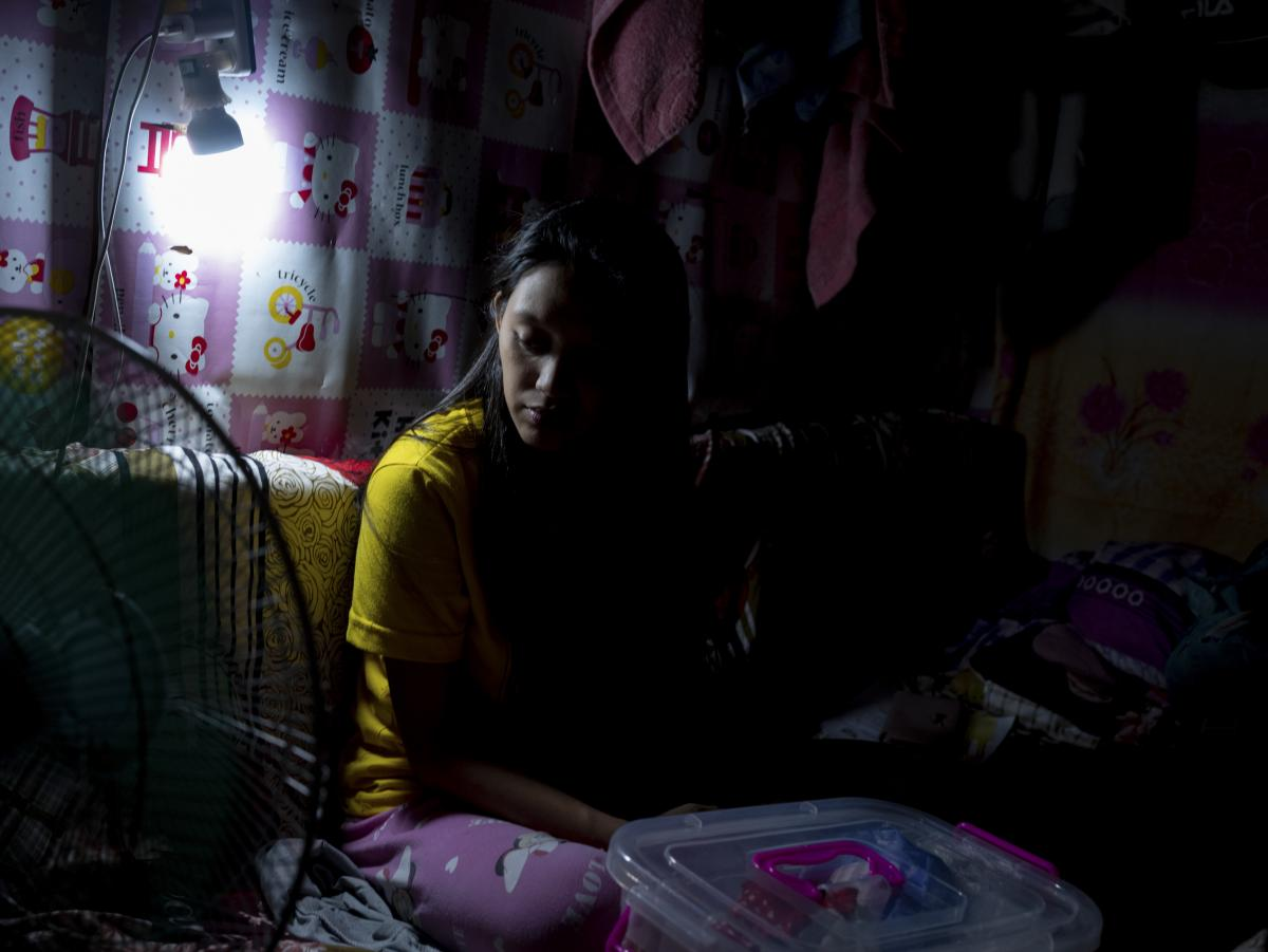 """Jianne 21, told photographer Xyza Cruz Bacani: """"I accidentally got pregnant and was scared when I gave birth because I was coughing. I was alone. Fear of getting the virus added to my worry. I gave up my son [for adoption] because they can give him a bett"""