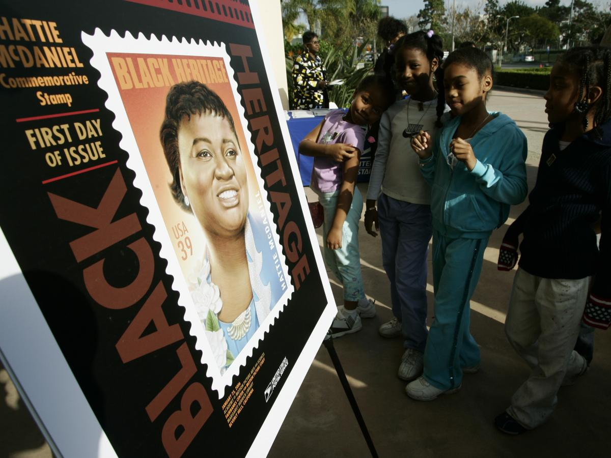 Los Angeles school children attend a ceremony unveiling a commemorative U.S. Postal Service stamp for actor Hattie McDaniel in 2006, in Beverly Hills, Calif. McDaniel, also a singer, radio and television personality, was the first African American to win