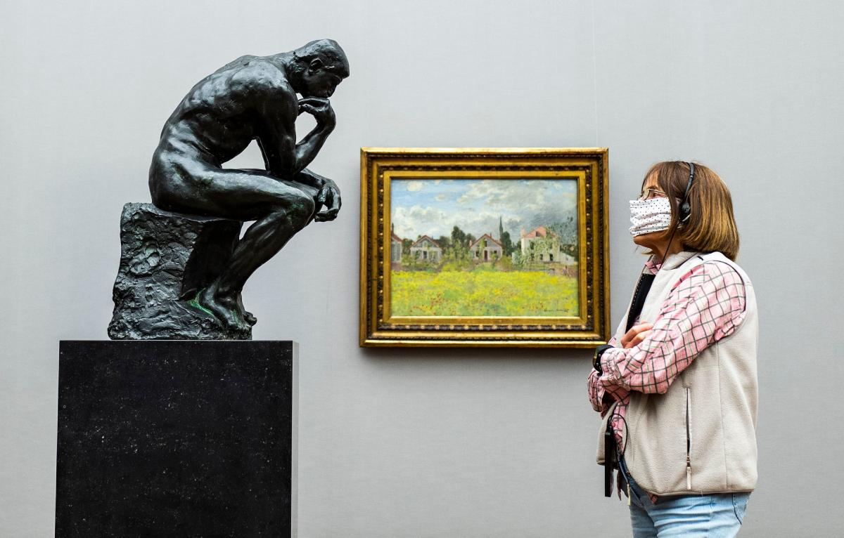 A visitor looks at Rodin's The Thinker at Alte Nationalgalerie in Berlin in May 2020.