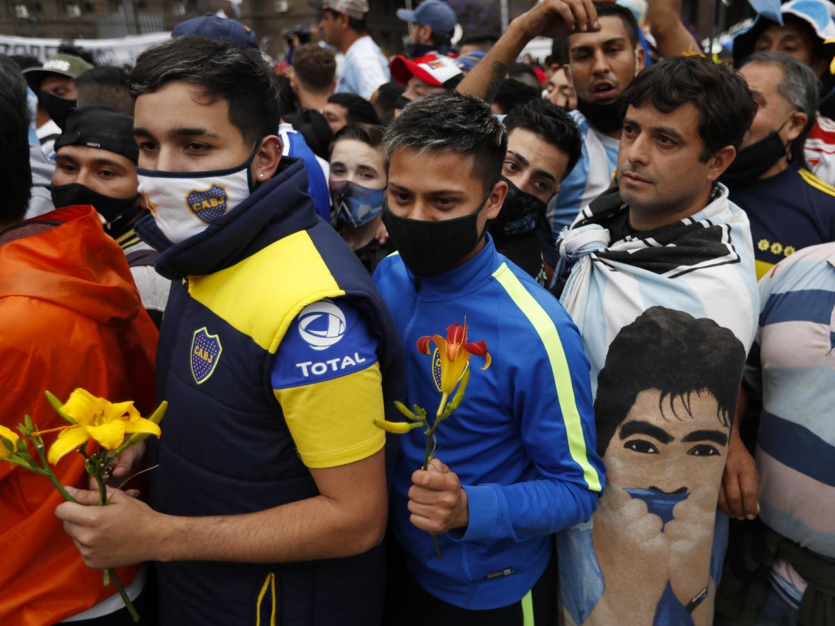 Fans line up to pay respects to Diego Maradona at the presidential palace in Buenos Aires on Thursday.
