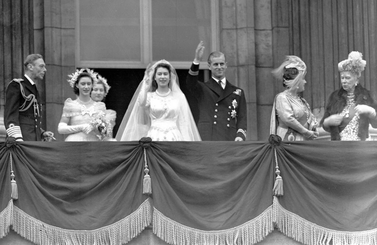 Britain's Queen Elizabeth II, then Princess Elizabeth, and Prince Philip, the Duke of Edinburgh, wave to the crowd from the balcony of Buckingham Palace after their wedding on Nov. 20, 1947. From left are King George VI, Princess Margaret, Lady Mary Cambr