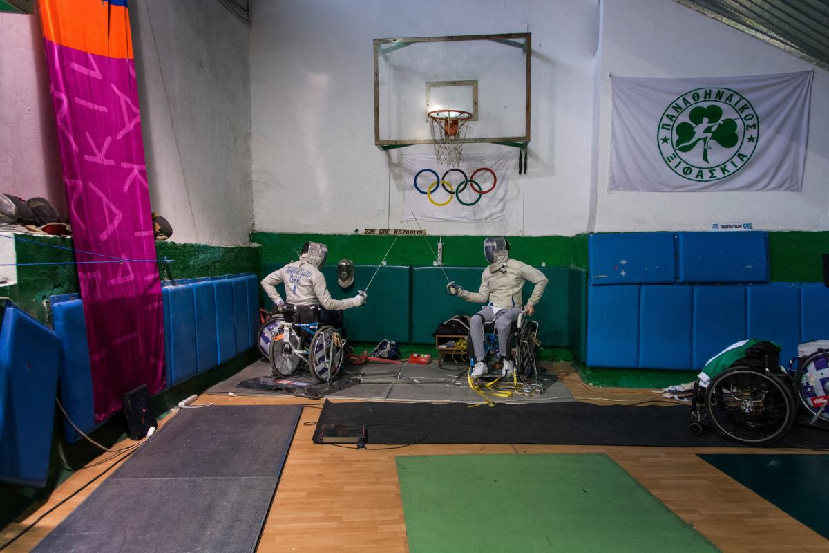 Triantafyllou (left) and Ntounis practice inside the small indoor court in Athens' Apostolos Nikolaidis Stadium, where Greece's national team consisting exclusively of people with disabilities is training.