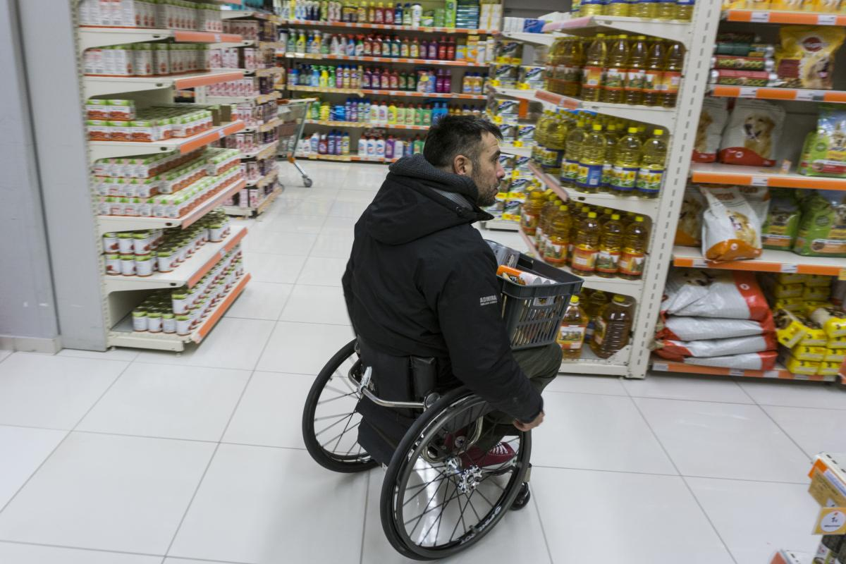 Triantafyllou shops at a local market. He was in a car accident in 2004 that left him paralyzed from the thorax down. When a product is on the top shelf, he usually asks for help.
