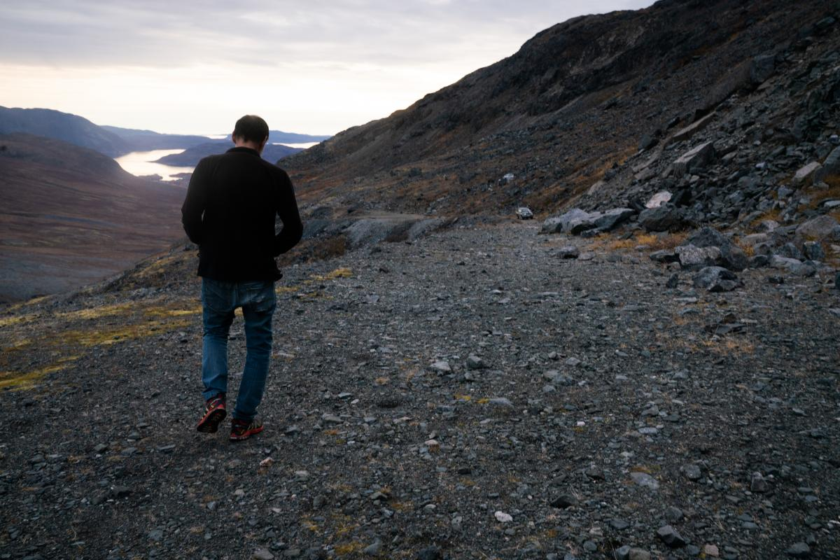 Pavia Rhodes, an employee of Greenland Minerals, walks at the Kvanefjeld project.