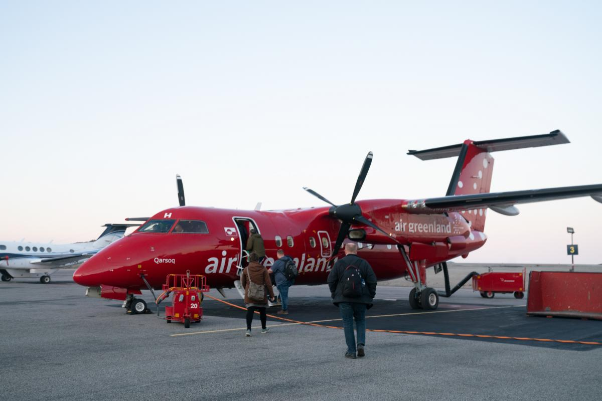People board a plane at the airport in Nuuk.
