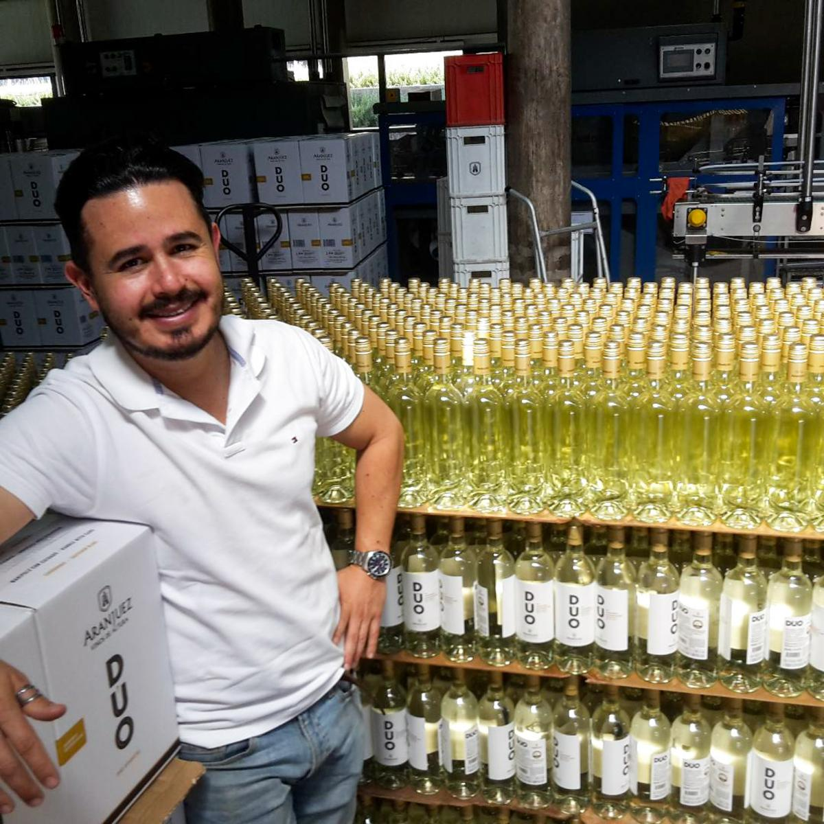 Gerardo Aguirre, export manager for the Aranjuez winery in Tarija, Bolivia, surrounded by bottles of the company's wines.