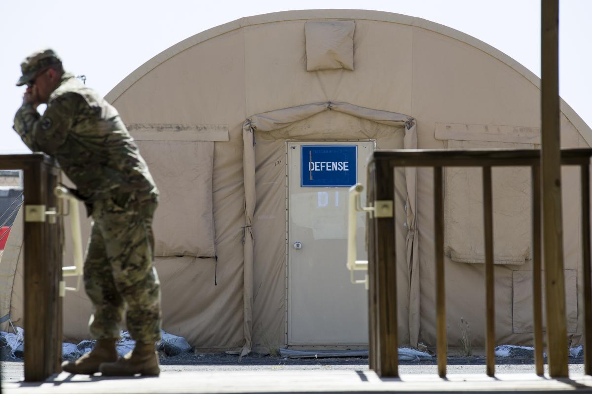 A U.S. Army soldier stands near a tent used by the defense teams for storage at Camp Justice on April 18, 2019, in Guantánamo Bay, Cuba.