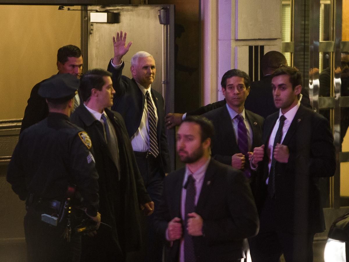 "Vice President-elect Mike Pence, top center, leaves the Richard Rodgers Theatre after a performance of ""Hamilton"" on Friday."