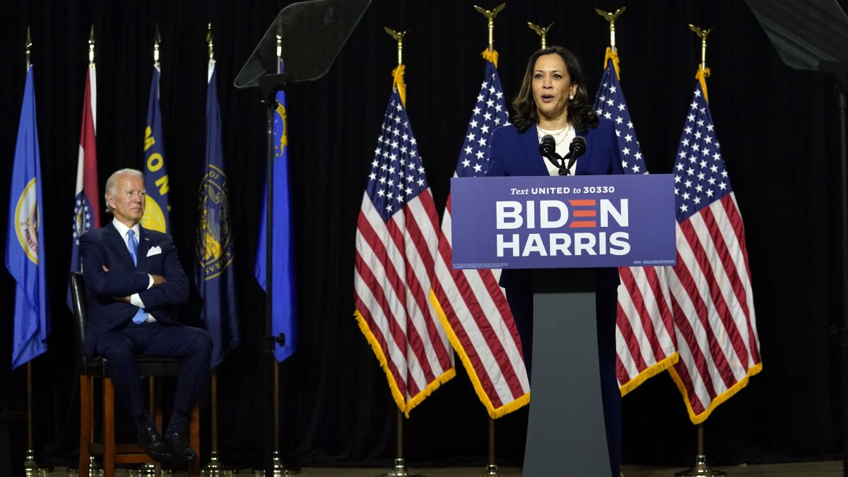 Biden listens as Harris speaks during their introductory event Wednesday at Alexis I. duPont High School.