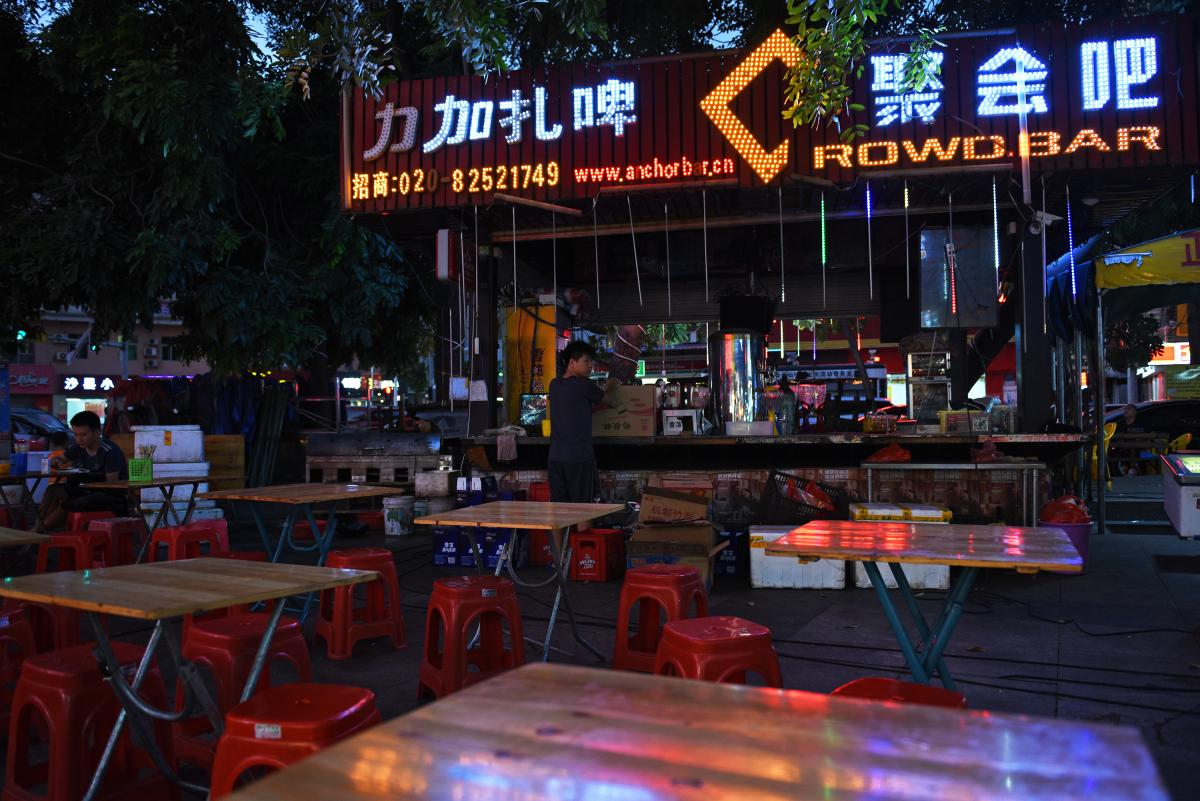 """Crowdbar is a food stall in an open-air market in Dongguan, across the street from a factory complex that specializes in making shoes. """"Right now, even the smallest vendors can't survive,"""" Crowdbar's owner says."""