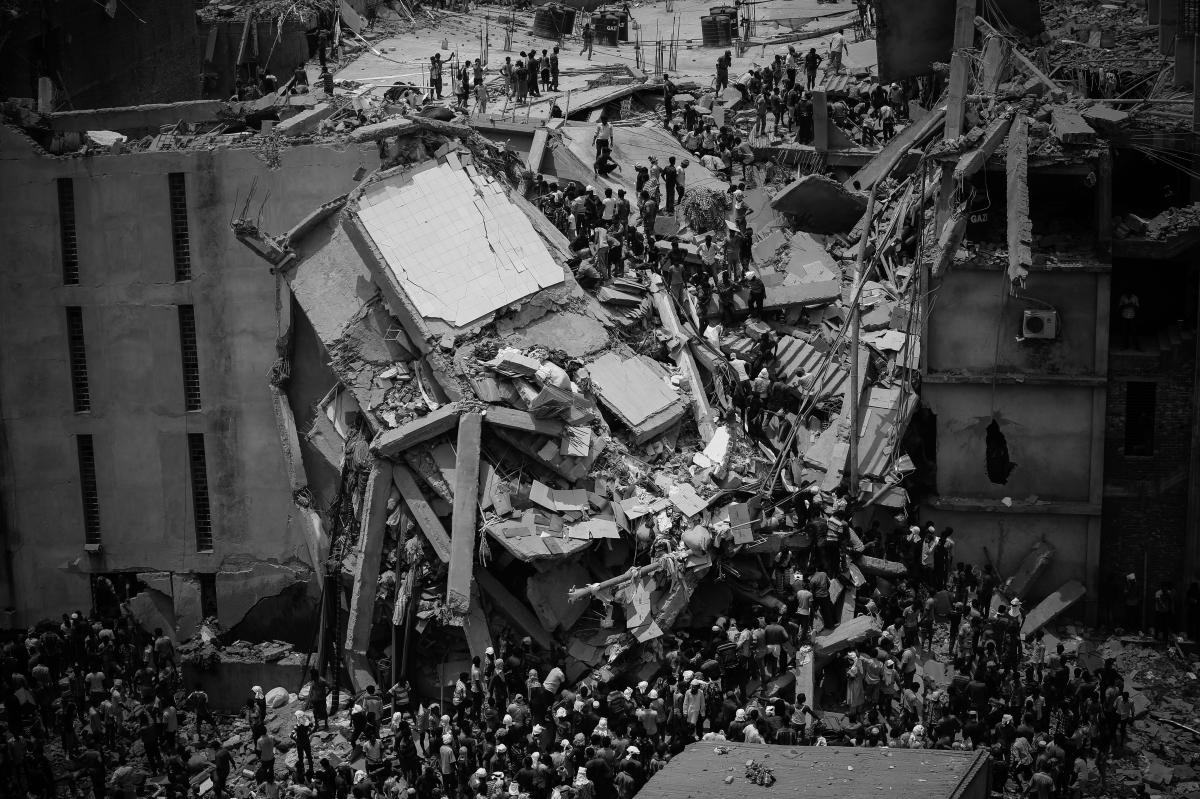People rescue garment workers trapped under rubble at the Rana Plaza after it collapsed in Savar, outside the Bangladesh capital of Dhaka, on April 24, 2013. The collapse of the Rana Plaza factory complex is considered Bangladesh's deadliest industrial di
