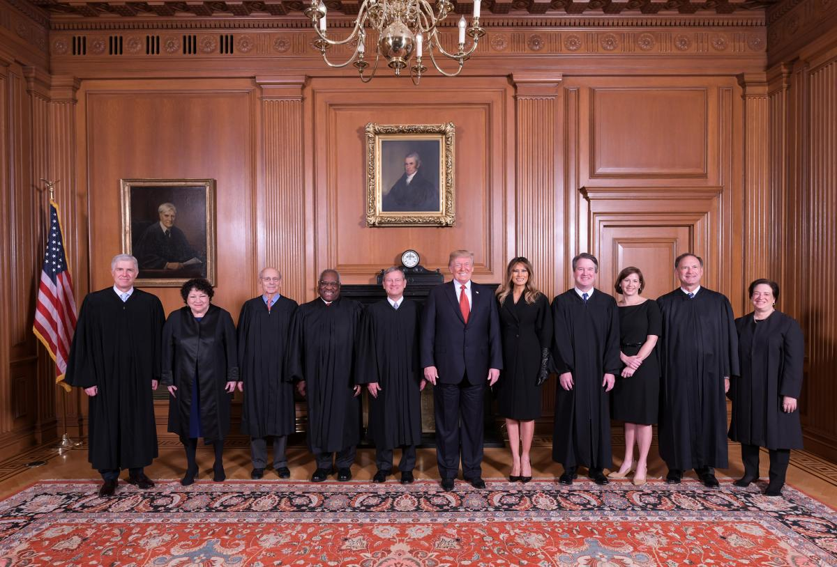 President Trump and first lady Melania Trump pose with Justice Brett M. Kavanaugh (fourth from right) and his wife, Ashley Kavanaugh, as well as other members of the Supreme Court in the justices' conference room before the investiture ceremony. Justice R