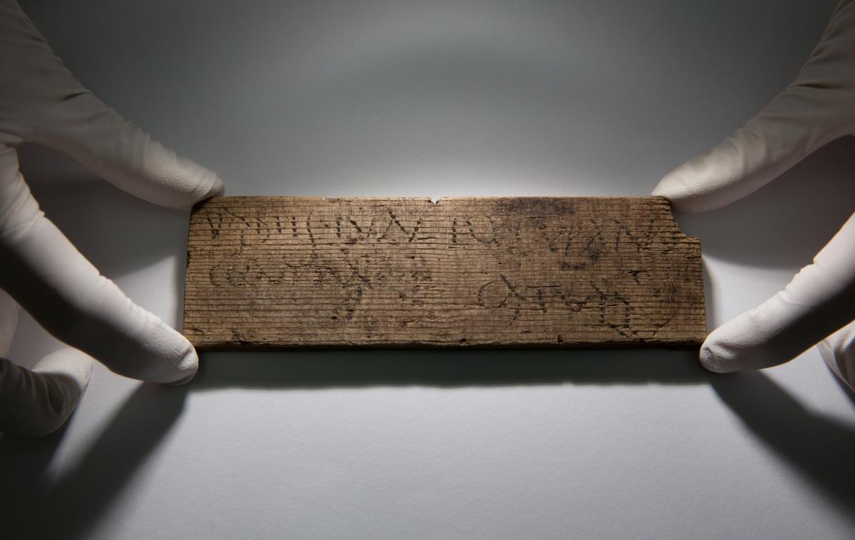 "This Roman waxed writing tablet, dated A.D. 80-90/5, reads ""You will give [this] to Junius the cooper, opposite [the house of] Catullus."""