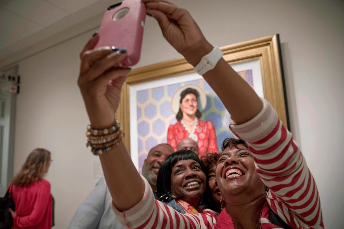 Relatives of Henrietta Lacks were on hand when her portrait went on display at the Smithsonian's National Portrait Gallery in Washington, D.C. Granddaughters Jeri Lacks Whye (right) and Kimberly Lacks (center) pose with other direct descendants for a self