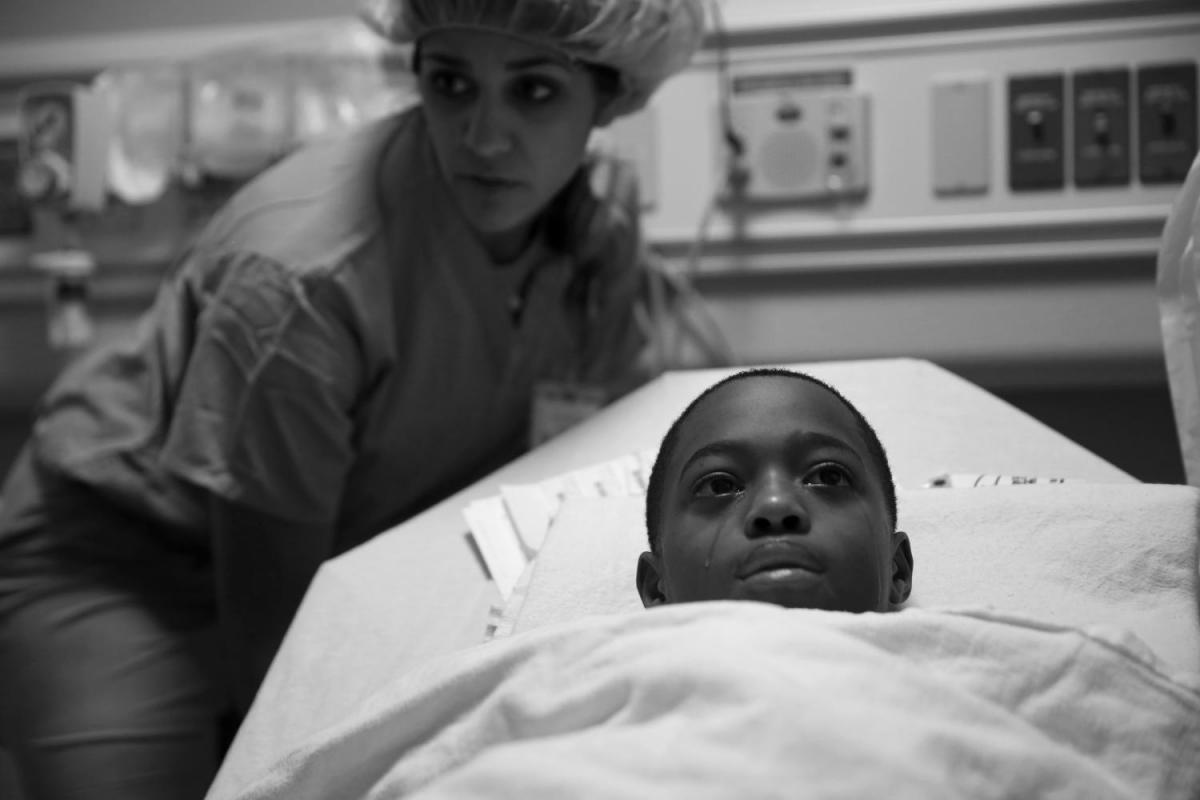 Tavon Tanner tears up before his surgery at Lurie Children's Hospital in October 2016. This photograph is part of the Chicago Tribune series that earned E. Jason Wambsgans the 2017 Pulitzer Prize.
