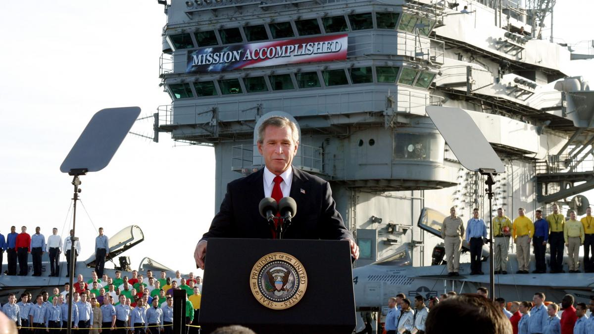 In this May 1, 2003 file photo, President George W. Bush speaks aboard the aircraft carrier USS Abraham Lincoln off the California coast.
